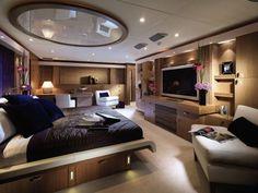 Under-bed lighting illuminates the floor area of the generous bedroom suites.