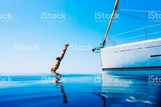 Man jumping in sea from sailboat royalty-free stock photo