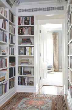 Bookshelves creating more function and utility from a hallway space