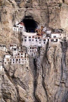 Small village in Tibet - I wouldn't even want to know the trip/requirements it takes to make it to this place of minimal needs. Wow, juat amazing, leaves me speechless just looking at it and thinking of the people who chose to live here and build into the earth. Beautiful!!