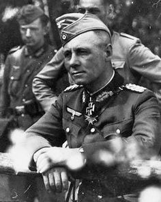 A rare photo of General (later Field Marshal) Erwin Rommel wearing a forage cap. With men of the 7th Panzer Division, France 1940. Rommel almost always wore his peaked cap or Schirmmütze.