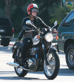Singer Pink is seen riding around the city on her motorcycle.