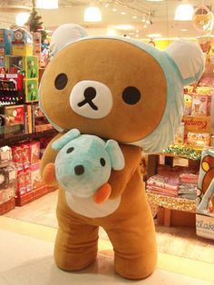 i am scared of people dressed in stuff like this but i would so give rillakkuma a big old hug