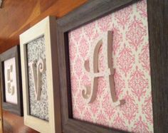 could DIY with wrapping paper and wooden letters?!