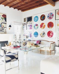 vinyl on the walls + white room with pops of color + eclectic + inspiring work space #8thandsupreme