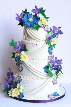 A beautiful wedding cake with fresh flowers