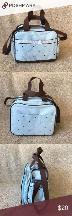 NWOT!!! Baby Bag Brand new without tag. Never used. This beautiful baby bag is baby blue and brown with brown handles and brown polka dots all around. There are 2 scrunched pouches on each side for a baby bottle and there are many compartments on the inside for baby essentials. Really cute! First Impressions Accessories Bags