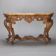 19th Century French Elaborately Carved Console  --  Circa 1880s French console has an elaborately carved base with shell form center decoration on apron and faux marble top.  --   Item:  6097  --  Retail Price:  $5495