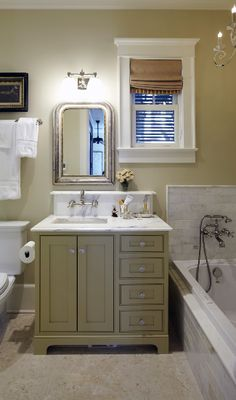 love the cabinet color for the guest bath, tile, and roman shade. via urban grace interiors.