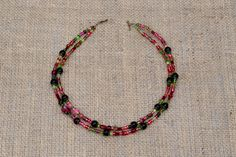 Pretty delicate two strand necklace in rich tones of pink green and purple by BijoubeadsLondon Purple Glass, Green And Purple, Strand Necklace, Boho Necklace, Green Necklace, Beaded Bracelets, Necklaces, Glass Beads, Delicate