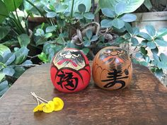 Japanese Set Of 2 Miniature 達磨 Lucky Daruma Kokeshi Dolls Good Luck And Long Life. Two lucky Daruma kokeshi dolls. One is painted in red while the other has the natural wood color. They have angry faces. One Daruma has the Fuku symbol 福 which means good fortune while the other has the
