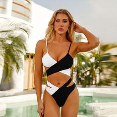 """Belle Mare Add some seriously sultry vibes to your poolside collection with this swimsuit. Featuring a material with extreme cut out design, we are obsessed. Team this with sandals and a matching sarong for a look that will steal stares. Length approx 81cm/32"""" (Based on a sample size UK 8) Model wears size UK 8/ EU 36/ AUS 8/ US 4 Model Height - 5ft 9"""" Sexy Bikini, Black Bikini Set, Bikini Bandeau, Black Swimsuit, Thong Bikini, Bikini Swimsuit, Honeymoon Swimsuit, Honeymoon Cruise, Bikini Underwear"""