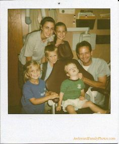 Hey, let's all take a family photo while he is knocked out at the dentists office.....smile!