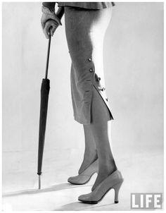 Longer look narrow gray flannel suit skirt w. buttoned slit by designer Pauline Trigere 1949
