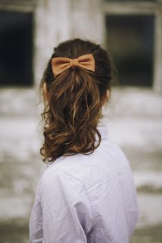 Ponytails and bows. So classic.