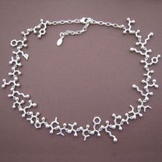 Endorphins choker from Made with Molecules.     So delicate and pretty and yet so lovely and scientific