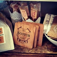 Cheers to you! Coasters, drink stirrers on wood.