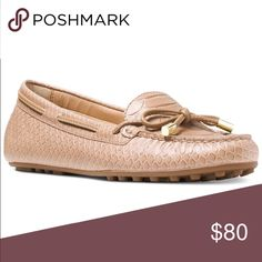 Michael Kors Daisy Moccasin Flats Dark Khaki MICHAEL Michael Kors updates the Daisy moccasin flats with perforations, embossing and metallic details for a casual, modern look. Fabric content and colors include: Embossed suede in cinnamon Perforated Vachetta leather in coral reef or navy Round closed-toe slip-on moccasin flats Bow tie-front with metallic embellishment Vachetta leather or suede upper; rubber sole Michael Kors Shoes Flats & Loafers
