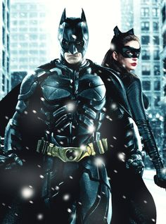 """Anne Hathaway as Catwoman/Selina Kyle & Christian Bale as Batman/Bruce Wayne in """"The Dark Knight Rises""""."""