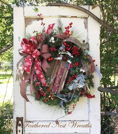 I love this Warm and Cozy Christmas Wreath!!! It is made on a Pine Base that I have Layered with Long Needle Pine, Icy and Frosted Berries, An Assortment of Sparkly Greenery and Small Rusty Jingle Bells. I have Added a Wooden Sled with the Word Joy and Finished out the Wreath with a Burgundy/Red Wired Gingham, a Linen Look Merry Christmas Ribbon and a Wired Red Ribbon with Snowflakes. This one exudes Warmth and Home!! It measures 29 in Length and is 28 Across...Measuring Tip to Tip.