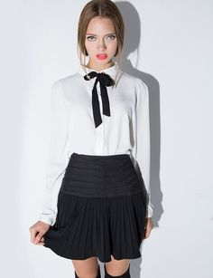 Pretty ivory blouse with black ribbon neck tie and eyelets. By Dahlia. *100% polyester*Length 24