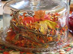 table glass centerpiece berries leaves fall thanksgiving.jpg