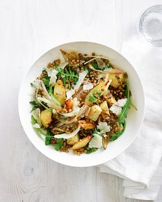 Honey-roasted shallots and parsnips are combined with green lentils, rocket and parsley in this hearty salad recipe.