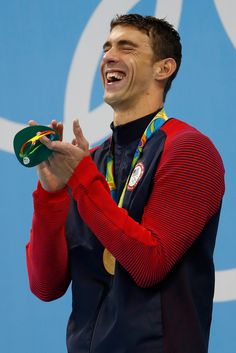 Gold medalist Michael Phelps of the United States celebrates on the podium during the medal ceremony for the Men's 200m Butterfly Final on Day 4 of the Rio 2016 Olympic Games at the Olympic Aquatics Stadium on August 9, 2016 in Rio de Janeiro, Brazil.