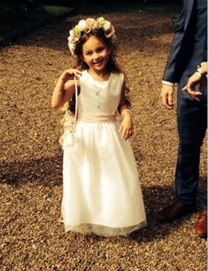 Chloe's cute little bridesmaid carrying a hoop and wearing a headdress both done in silk flowers.