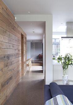 A wood panelled walkway gives great definition to this kitchen and living area. Designed by McCann Moore Architects Belfast. Concrete Interiors, Concrete Furniture, Concrete Wood, Wood Interiors, Condo Interior Design, Interior Walls, Best Interior, Interior Styling, Living Etc