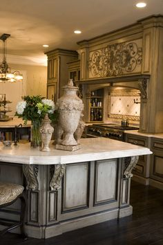 Two islands topped with richly textured Jerusalem stone. Love split island, bullnose and cabinets.