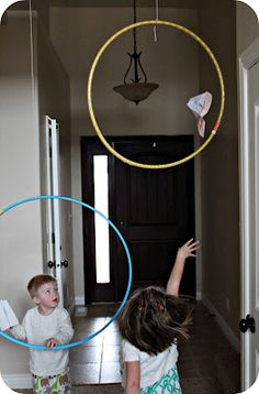 Flight School...with paper airplanes and hula hoops :) LOVE this!