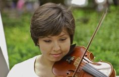 Almost a smile; young violinist; Rittenhouse Square; Philadelphia, Pennsylvania, USA.  September 2013.