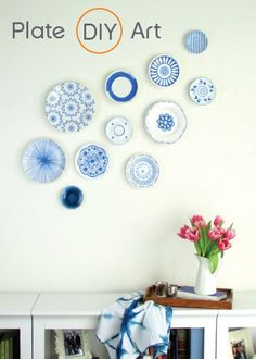 Do you own decorative plates and aren't sure what to do with them? Try hanging them on the wall in your dining room so you can display their beauty while creating your own unique art piece.