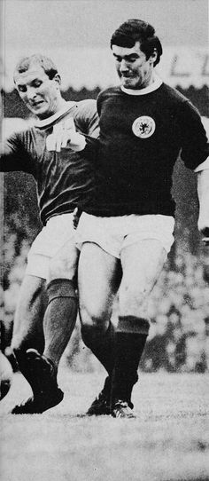 25th November 1964. Scotland captain Jim Baxter fighting over the ball with Northern Ireland's full back Jimmy Magill, at Hampden Park.