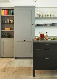 """Bespoke Oak Kitchens - sohofactory Hop Kiln 4  More from """"Plain English Design Ltd""""  Black 'furniture like' cabs, great utilitarian handles, soapstone countertop?, open shelves with full length storage cabs rather than uppers"""