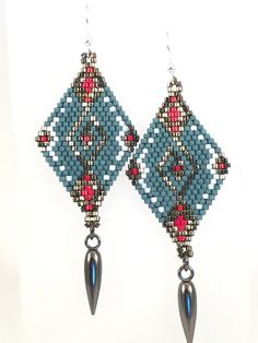 Handmade diamond shaped beaded earrings with intricate design. Visually moving design with colors merged with steel finished hex cut…