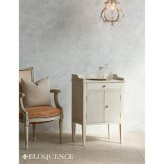 New! The Eloquence St. Lucia Nightstand. This charming piece has two carved cabinet doors and a delicate tray table style top. In Grain Sack finish.
