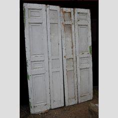A set of early Victorian bi-fold shutters