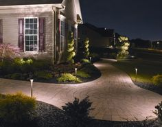 Low voltage lighting not only adds security to your home's exterior, but it allows you to highlight beautiful landscape specimen plantings, such as the japanese maple and juniper topiaries at this home.