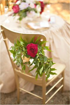 Lovely floral accents on a golden chair. #wedding #decor
