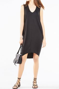 Re-define weekend chic in a sleeveless, sueded jersey look that effortlessly drapes for an easygoing fit and falls knee-length. Pullover.   Kerstin Dress by BCBG. Clothing - Dresses - LBD Canada