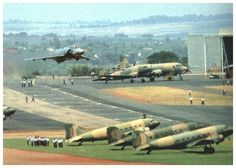 """""""South African Mirage flying over at an airfield"""""""