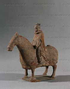 CHINESE SCULPTURE 6TH    Mongolian-type horse with caparison and rider. Funerary statuette, Northern Wei, terracotta. 5th-6th CE. The Chinese cavalry was created at about that time against the invasions of Mongol horsement. MG 19061  Musee Guimet, Paris, France