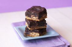 Peanut Butter Slutty Brownies with a peanut butter cookie crust, peanut butter cups, and brownie in every bite. These over the top treats are to die for!