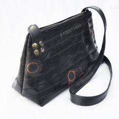 "Bag made from upcycled bike inner tubes - ""Raw"". $95.00, via Etsy."