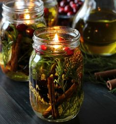 Make a Mason Jar Oil Candle Lamp Gifts for the Holidays - Candles - Ideas of Candles - Learn how to make a Mason Jar Oil Candle Lamp with beautiful botanicals and essential oils. They make great gifts and will last for a long time. Pot Mason Diy, Mason Jar Gifts, Mason Jar Candles, Mason Jar Lighting, Scented Candles, Candle Gifts, Floating Candles, Diy Hanging Shelves, Candle Lamp