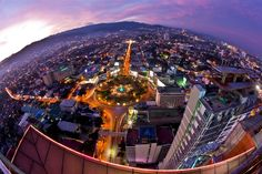 a fisheye capture of part of Cebu City from atop a skyscraper. I was looking for a pic of Cebu City, Philippines. Cebu City, Pictures Of Beautiful Places, Uk Visa, Exotic Wedding, May Bay, Historical Landmarks, Top Place, Capitol Building, Tourist Spots