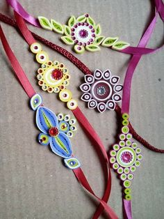 Quilled Rakhis from Sanskruti Art & Crafts. Arte Quilling, Paper Quilling Jewelry, Origami And Quilling, Quilling Earrings, Quilling Paper Craft, Paper Earrings, Paper Jewelry, Paper Beads, Quilling Patterns
