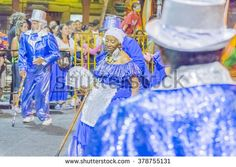 MONTEVIDEO, URUGUAY, JANUARY - 2016 - Group of costumed seniors having fun while marching at the inaugural parade of carnival of Montevideo, Uruguay